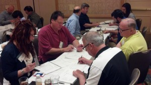 Attendees break into groups to review materials presented to this point, to ask speakers questions and/or discuss materials with other attendees. Starting clockwise with Melvin Kerr from Warehouse and Logistics Las Vegas (red shirt), Steve Kloos from Keller Warehousing, Ty Gilliam from Kelller Warehousing and Michelle Middleton, from Ohio Logistics-Findlay's Timber.